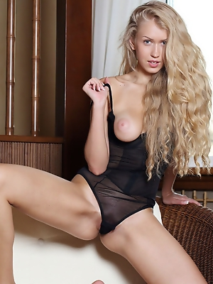 """The bewitching beauty of Kaylee A in sheer black lingerie, posing and teasing without any hint of inhibition"""