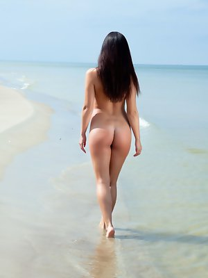 Darselle dazzles while she poses on the beach and plays in the water.