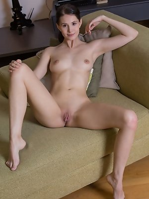 """""""Alluring Vanessa Angel strips and displays her naked, nubile body as she poses sensually on   the couch."""""""