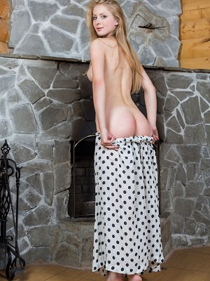 """""""A charming Daisy lifts the hem of her polka-dotted skirt, showing off her smooth legs, cute round butt, and pink snatch."""""""